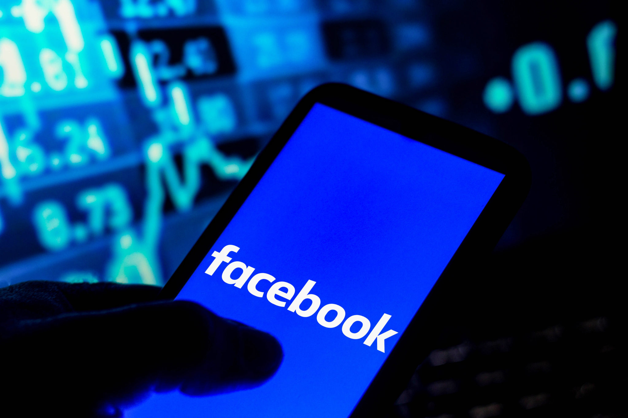 In this photo illustration the Facebook logo seen displayed